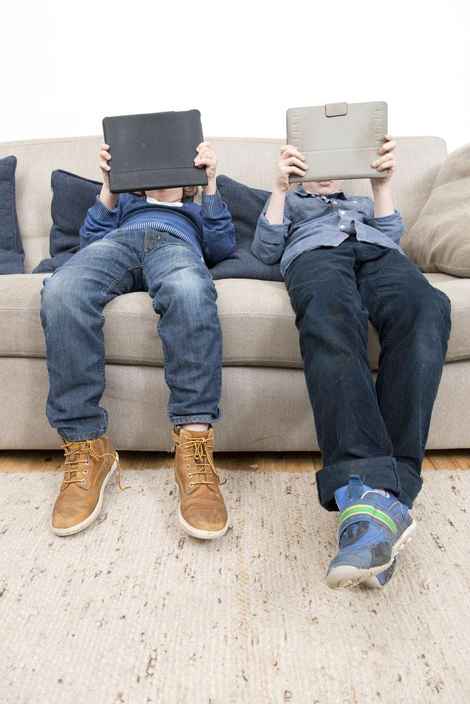 boys-slouching-using-ipads